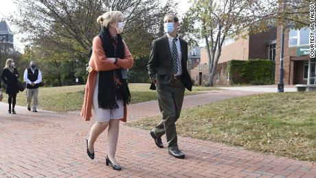 Deborah Birx walks on campus with her brother, Donald, the president of Plymouth State University.