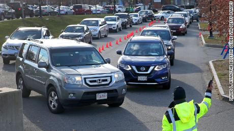 Drivers wait in long lines for drive-through testing outside the Lawrence General Hospital in Lawrence, Massachusetts, on Tuesday.