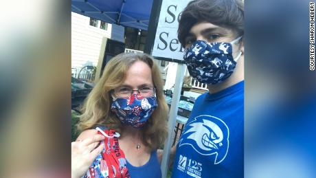 Sharon Hebert pictured with her son, Walter, wearing masks she sewed