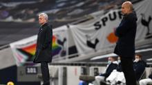 Mourinho and Guardiola look on during the match between Tottenham Hotspur and Manchester City.