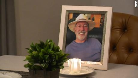 A photo of Lonnie and a candle stood in front his empty chair during their Thanksgiving dinner this year.