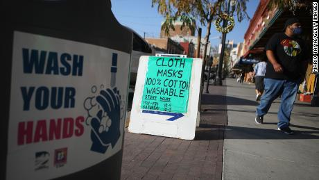 Masks are advertised near a hand washing station amid a surge of coronavirus cases in the city in El Paso, Texas.