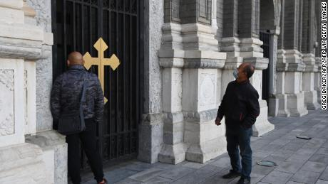 Two men look at St Joseph's Church, also known as Wangfujing Catholic Church, in Beijing on October 22, 2020.