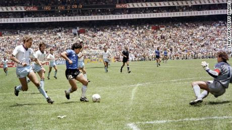 Diego Armando Maradona scoring an iconic goal against England at the 1986 World Cup