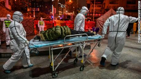 Medical workers in full protective clothing in Wuhan on January 25.