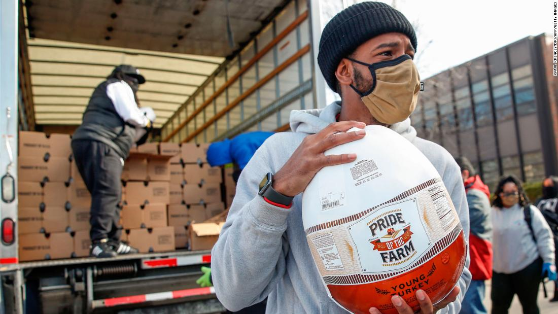 On behalf of the charitable foundation SocialWorks, volunteers in Chicago distribute free turkeys to those in need on November 23.