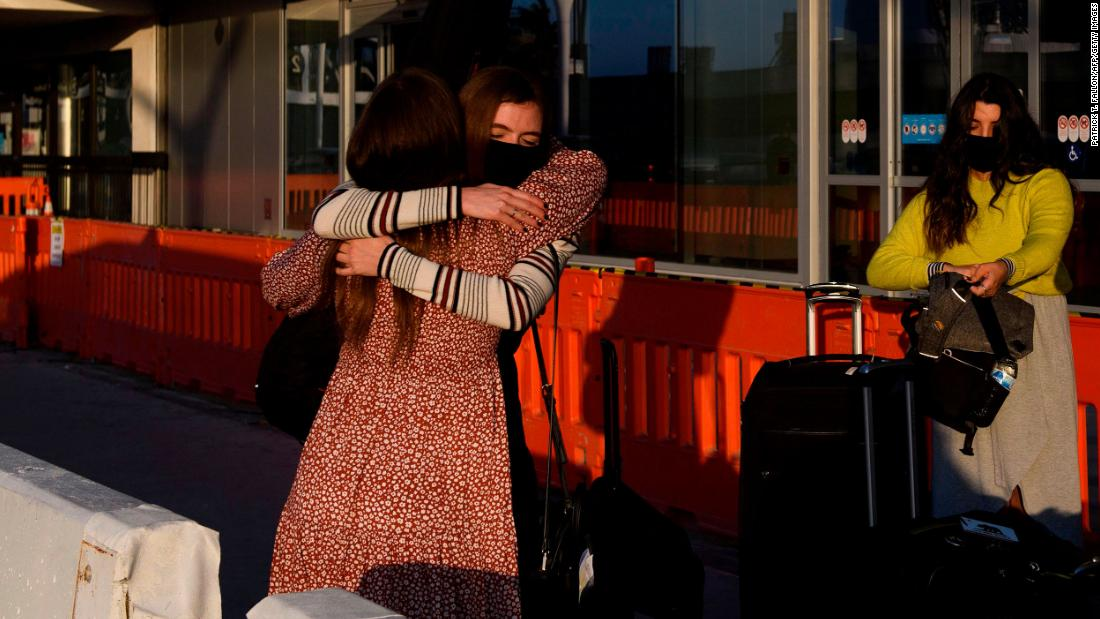 People say goodbye before checking in for a Delta Air Lines flight in Los Angeles on November 25.