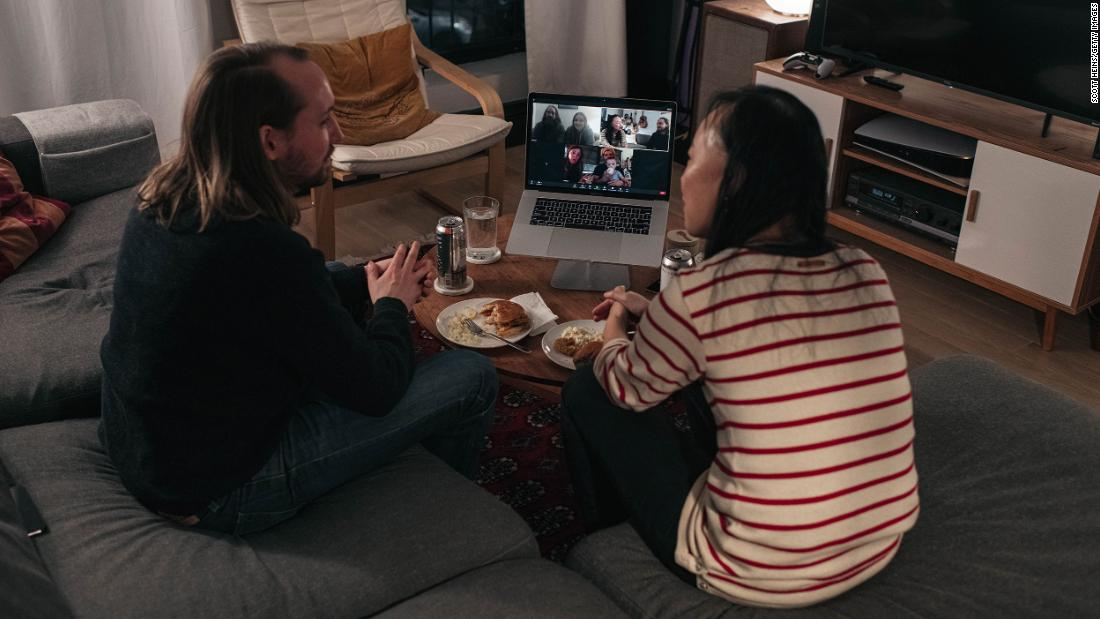 A couple in New York City uses a video call to take part in a Thanksgiving celebration with friends on November 22.