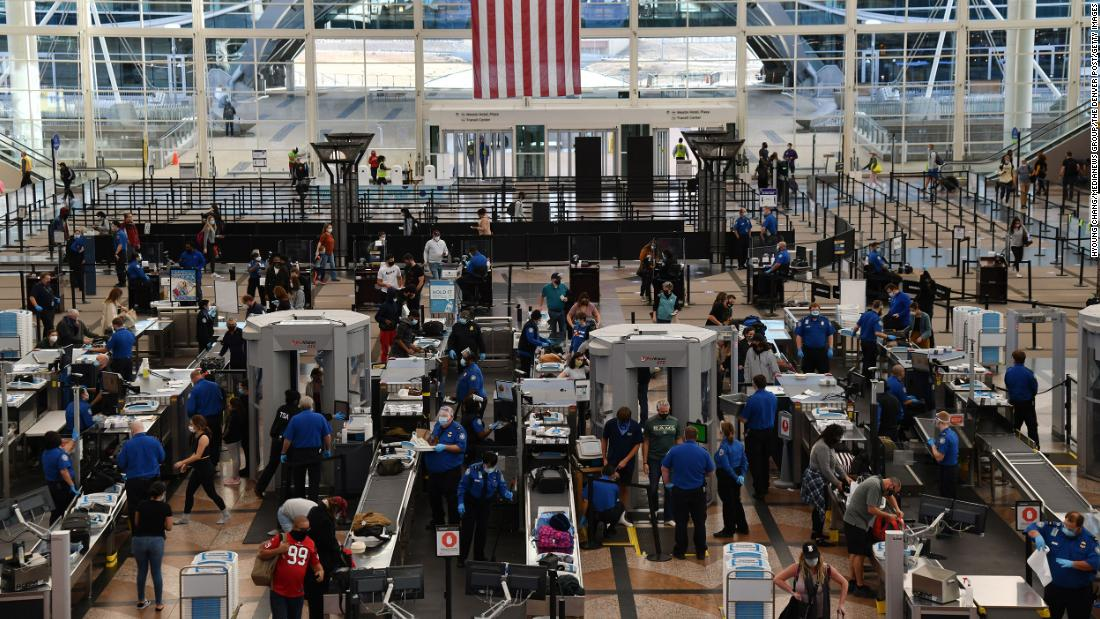 Employees with the Transportation Security Administration work at a checkpoint at Denver International Airport on November 20.