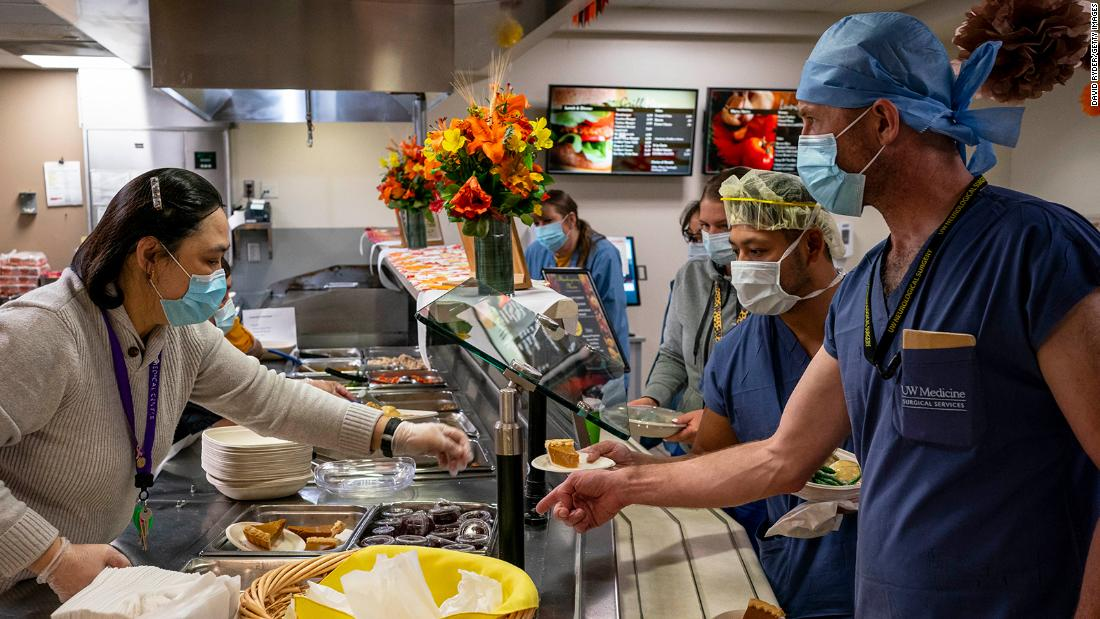 Cafeteria staff serve Thanksgiving meals to hospital personnel at the Harborview Medical Center in Seattle.