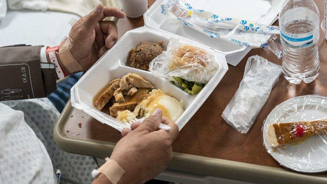 A patient eats a Thanksgiving meal at a Covid-19 intensive care unit in Houston.