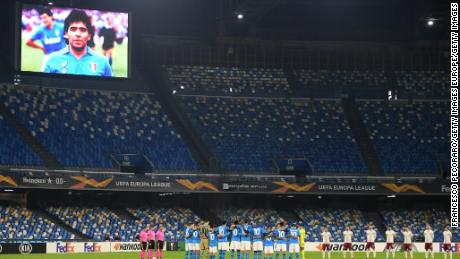 Players and officials observe a minute's silence in memory of Maradona.
