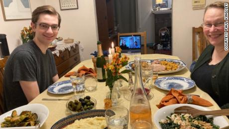 ポール's wife, Kathleen McGrath, and their son enjoy their Thanksgiving meal with a family Zoom call.