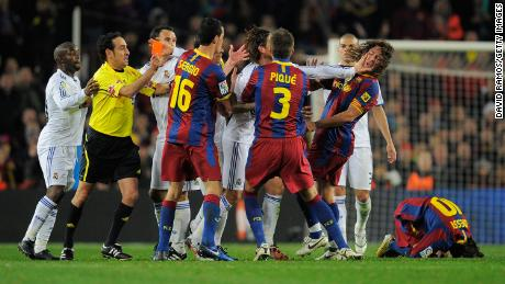 Sergio Ramos pushed Puyol in the face after a hacking tackle of Lionel Messi that saw him sent off.
