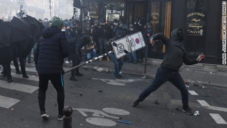 """Demonstrators clash with police during a protest against the """"global security"""" draft law in Paris, on Saturday, November 28, 2020."""