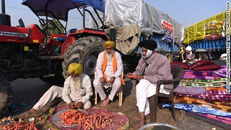 Farmers prepare food during day five of protests over farm reform laws at Singhu border on November 30, 2020 in New Delhi, India.