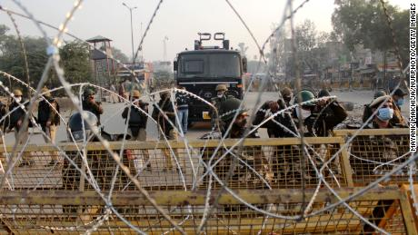 Security personnel deployed to stop farmers from entering the national capital during a protest against the Centre's new farm laws at Singhu border near Delhi, India on November 30, 2020.