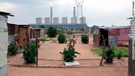 Many people have moved in from rural areas and neighboring Zimbabwe to find work at the Medupi coal power plant, pictured here from Maropong township outside Lephalele, South Africa in January 2015.