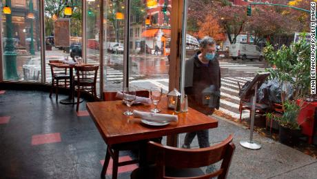 Bars and restaurants in New York began shutting early on November 13 under fresh curbs designed to slow soaring Covid-19 infections.
