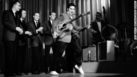 "American singer and musician Elvis Presley swivels his hips as he performs with his band onstage during his second appearance on ""The Ed Sullivan Show,"" on October 28, 1956."