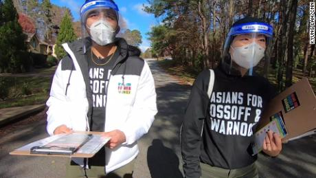 Volunteers Grace Pai and Syed Hussain go door to door to inform AAPI voters about Georgia's January runoff elections.