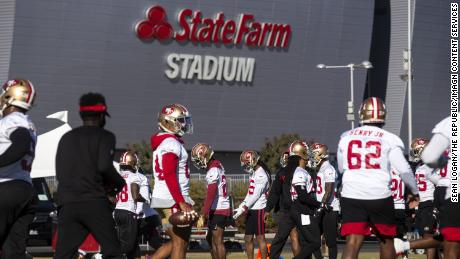 49ers players stretch during practice on December 3.