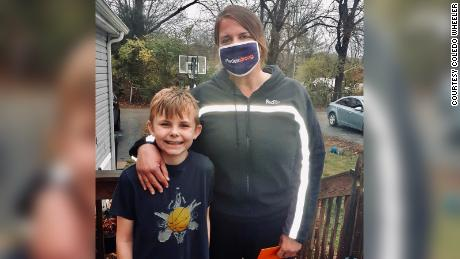 A FedEx driver surprised a boy with a new basketball and hoop after she noticed him playing with a broken one