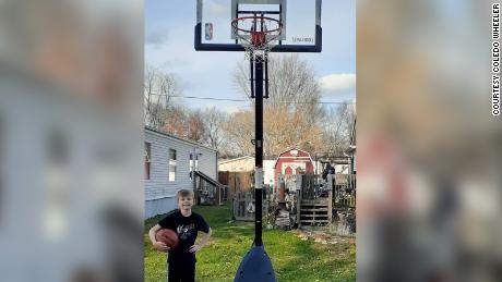 Elijah and his new basketball hoop.