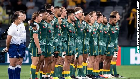 Australia sings the national anthem during the Tri-Nations rugby match between the Australian Wallabies and Argentina Pumas on December 5, 2020 in Sydney.
