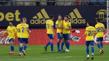 Cádiz players celebrate their opening goal against Barcelona.