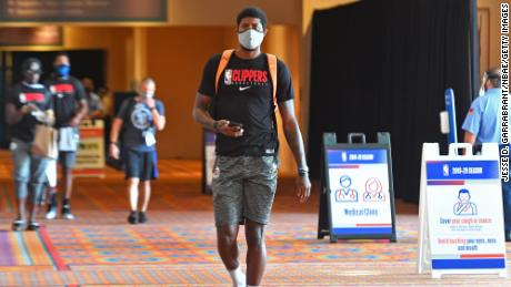 Paul George #13 of the LA Clippers arrives during practice as part of the NBA Restart 2020 on July 21, 2020 in Orlando, Florida.