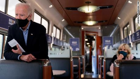 Joe Biden and his wife Jill Biden, right, speaks with invited families aboard an Amtrak train, Wednesday, September 30, 2020, as it makes its way to Alliance, Ohio.