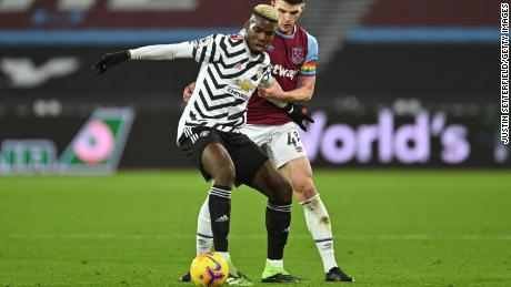 Pogba is challenged by Declan Rice of West Ham United during the Premier League match between West Ham United and Manchester United.