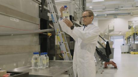 Joerg Hess, COO of Aquaporin A/S, checks water that has been filtered using the aquaporin membrane.