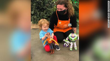 Sarah Hurberdeau, an associate at The Home Depot,  helps reunite 2-year-old Desmond with his lost Woody doll.