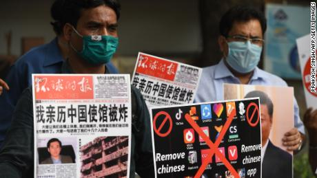 Members of the Working Journalist of India hold placards urging citizens to remove Chinese apps and stop using Chinese products during a demonstration in June.