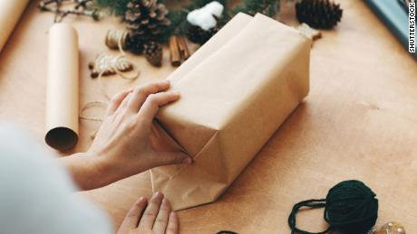 Brown paper packages tied up with string are a trendy and inexpensive alternative.