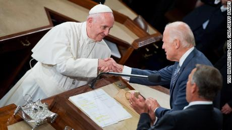 Pope Francis greets then-Vice President Joe Biden, center, and Speaker John Boehner, R-Ohio, in the House chamber of the US Capitol before he addressed a joint meeting of Congress, September 24, 2015.