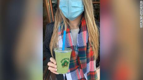 Julie Spero models a mask while holding a smoothie. 뉴저지's PSA campaign wasn't limited to influencers but included Instagram food blogs like Spero's which is known as Hoboken Hungry.