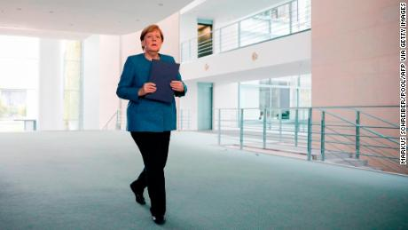 """German Chancellor Angela Merkel said Navalny was """"definitely"""" the victim of a crime and called on the Russian government to answer what she called """"very serious questions."""""""