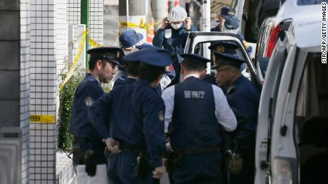 Policemen prepare for inspection in front of an apartment in Zama, Kanagawa prefecture, in novembre 2, 2017, where police found nine dismembered corpses.