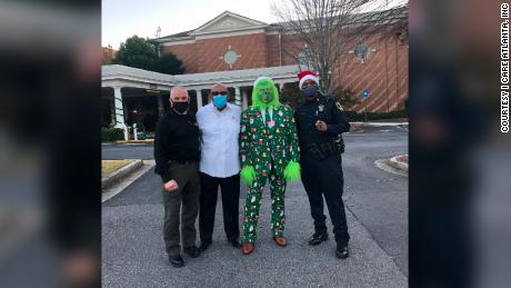 I Care Atlanta partnered with local  police for a Christmas for Kids event.