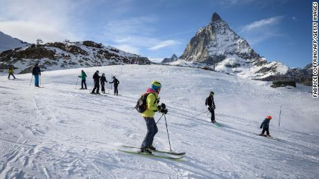 Skiers hit the slopes in the Swiss Alps on November 28.