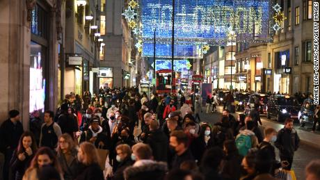 Christmas illuminations are seen above shoppers on London's Regent Street on December 15.