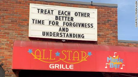 A message of encouragement is displayed above the bowling alley's restaurant.