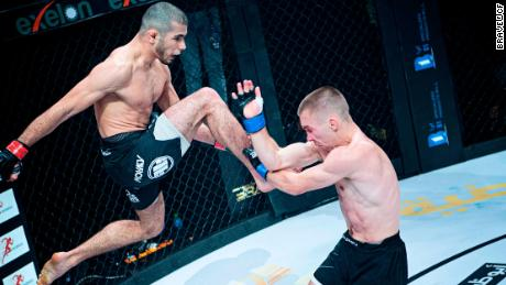 Mokaev (left) aims a knee at Jamie Kelly during Brave CF 43 in Bahrain.