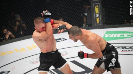 Mokaev (right) punches Jamie Kelly during Brave CF 43 in Bahrain.