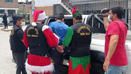 Peruvian police dress as Santa and elves for drug raid