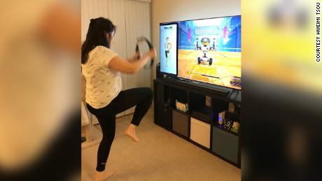 Bay Area resident Hweimei Tsou works out at home with Ring Fit Adventure on Nintendo Switch. Here she does knee lifts.