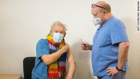 Ian McKellen talks to Dr Phil Bennett-Richards as he receives his first dose of the Covid-19 vaccine at the Arts Research Center, Queen Mary University Hospital.